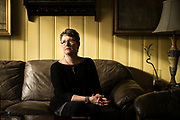 "PENSACOLA, FL – FEBRUARY 19, 2018: Betsy LeGallais, 54, sits in the living room of her Pensacola home. LeGallais estimates she and her mother have spent $120,000 over the years on addiction treatment for her now 25-year-old daughter, Anna Lewis, who first encountered opiates through prescription drugs during high school. Her daughter's opioid addiction quickly led to heroine use, then alcohol, and a few months ago co-payments for Ms. Lewis's latest round of detox took what little savings Ms. LeGallais had begun to build back up again. Despite the financial hardship, LeGallais is still hopeful. ""Anna sought help on her own,"" she said, ""so I fully support her in her journey to sobriety. It's nothing to be ashamed of anymore. This is a true disease."" <br /> <br /> The addiction crisis that is killing tens of thousands of Americans every year is also creating a financial crisis for many families, compounding the anguish caused by a loved one''s destructive illness. Families are burning through savings and amassing huge debt paying for rehab that often doesn't work. According to the Substance Abuse and Mental Health Services Administration, federal data show that 22.5% of admissions for substance-abuse treatment involve someone who's already had one previous round of treatment, and another 21% involve people who ha've had two or three previous rounds. The predicament reflects both the difficulty of treating addiction, and the haphazard rehabilitation and insurance system many patients face. <br /> CREDIT: Bob Miller for The Wall Street Journal"