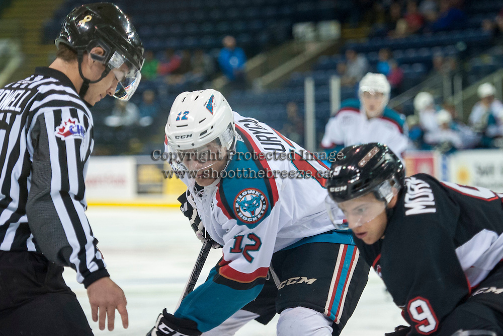 KELOWNA, CANADA - SEPTEMBER 5: Alexander Uryga #12 of Kelowna Rockets faces off against Brad Morrison #9 of Prince George Cougars on September 5, 2015 during the first pre-season game at Prospera Place in Kelowna, British Columbia, Canada.  (Photo by Marissa Baecker/Shoot the Breeze)  *** Local Caption *** Alexander Uryga;