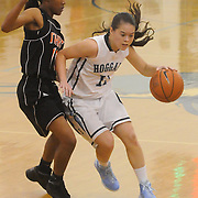 Hoggard's Tara Poteat drives around New Hanover's Taylor Perkins Friday December 12, 2014 at Hoggard High School in Wilmington, N.C. (Jason A. Frizzelle)