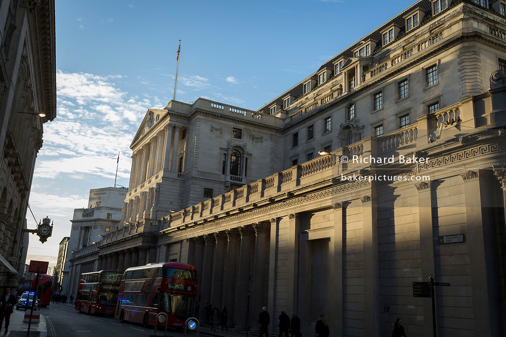 "Exterior of the Bank of England on Threadneedle Street in the Square Mile, the capital's financial district, on 13th November 2017, in the City of London, England. The Bank of England, is the central bank of the United Kingdom and the model on which most modern central banks have been based. Established in 1694, it is the second oldest central bank in the world. Sir Herbert Baker's rebuilding of the Bank, demolishing most of Sir John Soane's earlier building, was described by architectural historian Nikolaus Pevsner as ""the greatest architectural crime, in the City of London, of the twentieth century""."