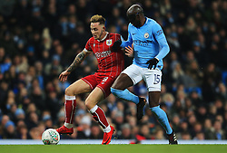 Josh Brownhill of Bristol City takes on Eliaquim Mangala of Manchester City - Mandatory by-line: Matt McNulty/JMP - 09/01/2018 - FOOTBALL - Etihad Stadium - Manchester, England - Manchester City v Bristol City - Carabao Cup Semi-Final First Leg