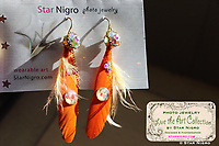 """Flower photo jewelry earrings by Star Nigro<br /> <br /> Materials: orange flower photo, 22K gold accents, orange feathers, swarovski crystals, sterling silver earring hooks<br /> <br /> size: 2"""" x 1/8""""<br /> <br /> price: $64.00<br /> <br /> photo jewelry: Star Nigro<br /> photo by: Star Nigro<br /> model:Palma Latorre artist/fx artist<br /> <br /> gorgeousfrankenfx.wixsite.com/gffx<br /> https://www.facebook.com/GF.effects/"""