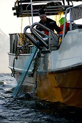 NORWAY LOFOTEN HENNINGSVAER 28MAR07 - A cod fishing boat hauls in its catch off Henningsvaer on the Lofoten islands...jre/Photo by Jiri Rezac..© Jiri Rezac 2007..Contact: +44 (0) 7050 110 417.Mobile:  +44 (0) 7801 337 683.Office:  +44 (0) 20 8968 9635..Email:   jiri@jirirezac.com.Web:    www.jirirezac.com..© All images Jiri Rezac 2007 - All rights reserved.