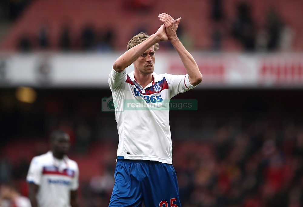 Stoke City's Peter Crouch gestures to the fans after the Premier League match at The Emirates Stadium, London.
