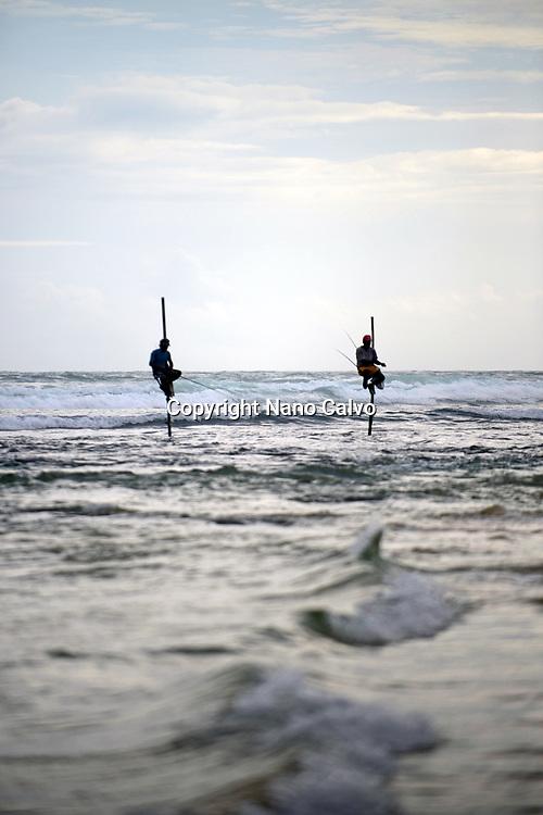Stilt fishermen in Ahangama coast, Sri Lanka