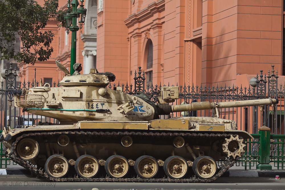 Tank in front of the Egyptian Museum in Tahrir Square. Protests in Cairo rocked the country on January 25th and went on for 18 days resulting in the toppling of Mubarak ending his 30 year old regime following in the footsteps of Tunisia's revolution.