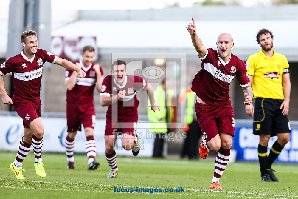Ryan Cresswell of Northampton Town (2nd right) turns to celebrate after scoring during the Sky Bet League 2 match at Sixfields Stadium, Northampton<br /> Picture by Andy Kearns/Focus Images Ltd 0781 864 4264<br /> 11/10/2014