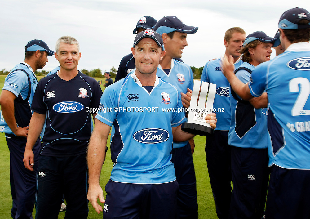Auckland Aces captain Gareth Hopkins with the men's one day competition trophy following the team photo. Canterbury Wizards v Auckland Aces in the One Day Competition Final. QEII Park, Christchurch, New Zealand. Sunday, 13 February 2011. Joseph Johnson / PHOTOSPORT.