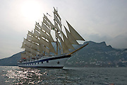 The Royal Clipper passing Amalfi under full sails.