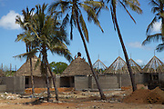 Local builders working on the construction of new accomodation in Mtwara...Mtwara is under going a lot of growth due in part to the investment of oil companies in the area...VSO is working in partnership with BG group and VETA, a local vocational training centre, to help train local people so as they can find employment.
