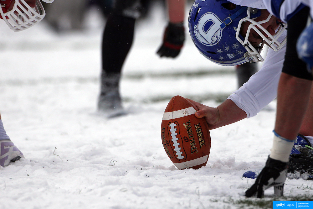 Snow covered Darien linemen prepare for the snap during the New Canaan Rams Vs Darien Blue Wave, CIAC Football Championship Class L Final at Boyle Stadium, Stamford. The New Canaan Rams won the match in snowy conditions 44-12. Stamford,  Connecticut, USA. 14th December 2013. Photo Tim Clayton