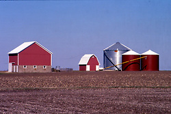 Farmstead painted red Note: This image was originally produced on film and scanned to produce a digital file.  Some dust may be visible from that scan