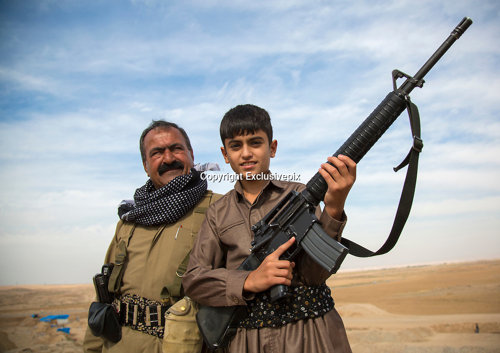 The Dads' Army fighting Isis: One-eyed veterans forced to fight jihadis with nothing but rusty AK47s from 1960 and wearing cast-offs from US army<br /> <br /> <br /> *The veterans have taken up arms in Iraqi towns threatened by ISIS<br /> <br /> *Among dysfunctional army are grandfathers and Gulf War soldiers<br /> <br /> *Rusty AK47s and second-hand grenades are their only weaponry<br /> <br /> Weathered and war-weary, these are the Dad's Army warriors fighting to free a country for which many have fought before.<br /> They are the Kurdish volunteers on the battlefield of Iraq's bloody war against the Islamic State jihadis ravaging their homeland.<br /> And while many look like they'd better belong in line for a free bus pass than on the frontline, their advancing years belie their bravery.<br /> <br /> <br /> I meet them in the Iraqi town of Taza Kharmatho, just south of Kirkuk city, where war is raging.<br /> Dressed proudly in handed-down uniforms, they yield weapons leftover from bygone wars, including AK47s dating from the 1960s.<br /> One day, alongside a tank, Russian grenade launcher and a handful of machine guns, these were all they had to fight with.<br /> <br /> By contrast, the ISIS fighters are armed with state-of-the-art weaponry stolen from the Iraqi army or seized from wayward U.S. airdrops meant for Peshmerga Kurds.<br /> <br /> Where these seasoned soldiers negotiate the muddy roads (we saw heavy rain for five days here) in four-wheel-drives, ISIS have hummers.<br /> Nevertheless, they have no choice but to fight with what they have - despite hollow promises from the U.S. and Europe to arm them adequately.<br /> One, who did not want to give his name but has returned to Iraq from London where he has lived for many years, told me his AK47 is indeed from the 1960s.<br /> 'My weapon is an AK47 that I saved up my own money for and bought on the black market to fight ISIS to save my country,' he tells me proudly, holding his rattling rifle with both ha