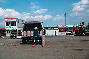 Huixcolotla, Mexico – March 27, 2017: A woman sells stolen gasoline from pipelines that connects Minatitlan, Veracruz with Mexico City.