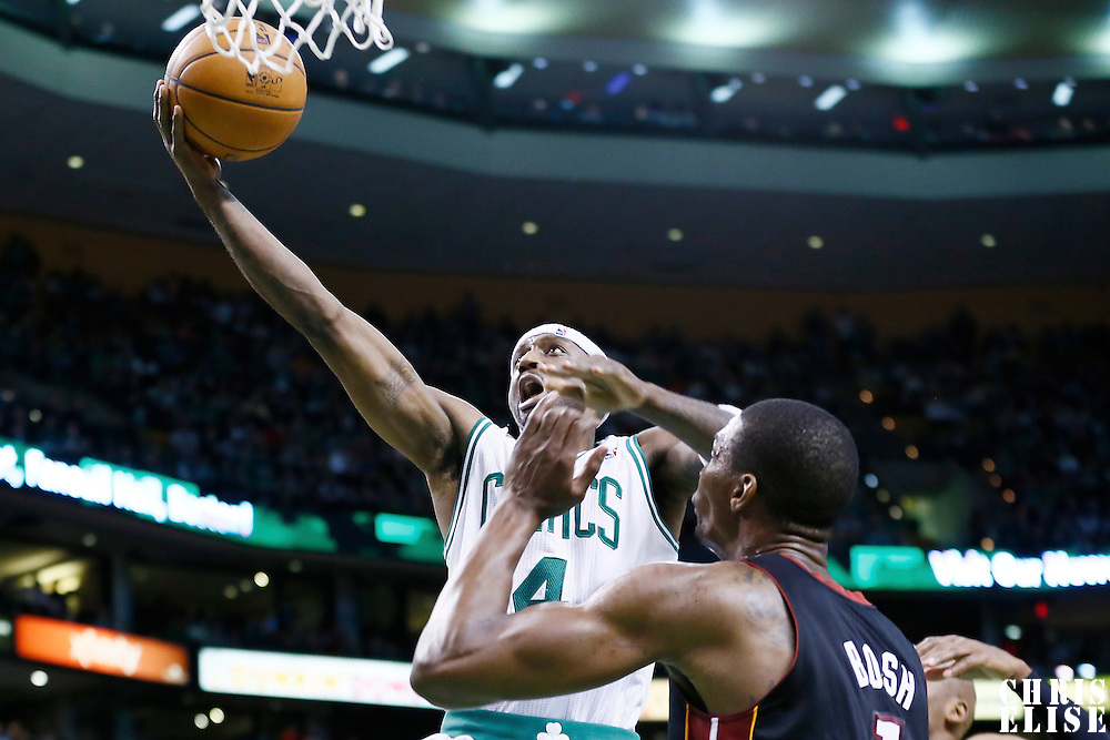 27 January 2013: Boston Celtics shooting guard Jason Terry (4) goes for the layup past Miami Heat center Chris Bosh (1) during the Boston Celtics 100-98  2OT victory over the Miami Heat at the TD Garden, Boston, Massachusetts, USA.