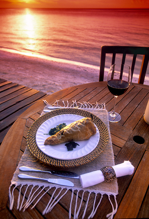 At sunset chile sarape is served beachside at the French restaurant, Mi Capricho on Isla de Holbox, Mexico.