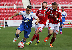 Peterborough United's Connor Washington is watched by Swindon Town's Jordan Turnbull and Anton Rodgers - Photo mandatory by-line: Joe Dent/JMP - Mobile: 07966 386802 - 11/04/2015 - SPORT - Football - Swindon - County Ground - Swindon Town v Peterborough United - Sky Bet League One