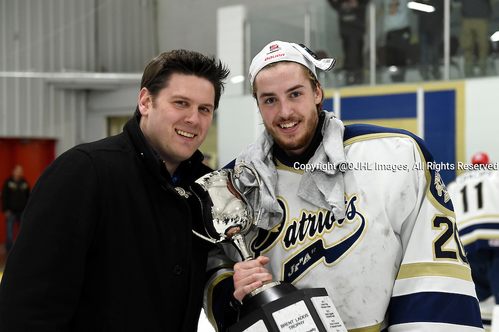 TORONTO, ON - Apr 22, 2015 : Ontario Junior Hockey League game action between the Toronto Patriots and the Kingston Voyaguers. Game seven of the Buckland Cup Championship Series. Toronto Patriots Assistant GM Ryan Daniels and MVP Mathew Robson #20.<br /> (Photo by Andy Corneau / OJHL Images)
