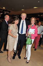 Left to right, SIR IAN & LADY LOWSON and LADY ALEXANDRA ETHERINGTON at a preview evening of the annual London LAPADA (The Association of Art & Antiques Dealers) antiques Fair held in Berkeley Square, London on 18th September 2012.