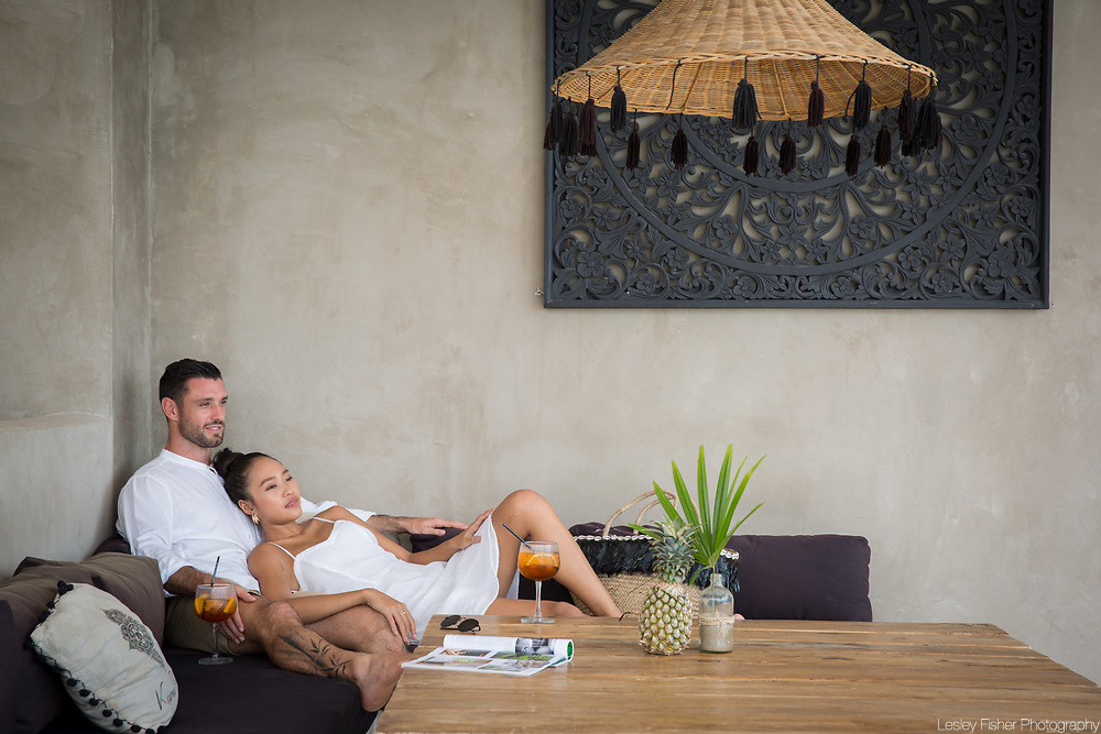 A couple relaxing with an aperatif at Karma Beach Resort, a unique resort located on Bophut Beach, Koh Samui, Thailand