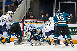 March 8, 2011; San Jose, CA, USA;  San Jose Sharks goalie Antti Niemi (31) saves a shot from Nashville Predators center David Legwand (11) during the first period at HP Pavilion. San Jose defeated Nashville 3-2 in overtime. Mandatory Credit: Jason O. Watson / US PRESSWIRE