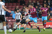 Callum Camps shoots during the EFL Sky Bet League 1 match between Scunthorpe United and Rochdale at Glanford Park, Scunthorpe, England on 24 March 2018. Picture by Daniel Youngs.