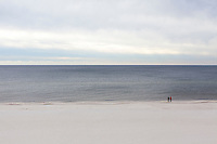 Two people have the beach all to themselves in Orange Beach, Alabama, Thursday, Dec. 3, 2015.