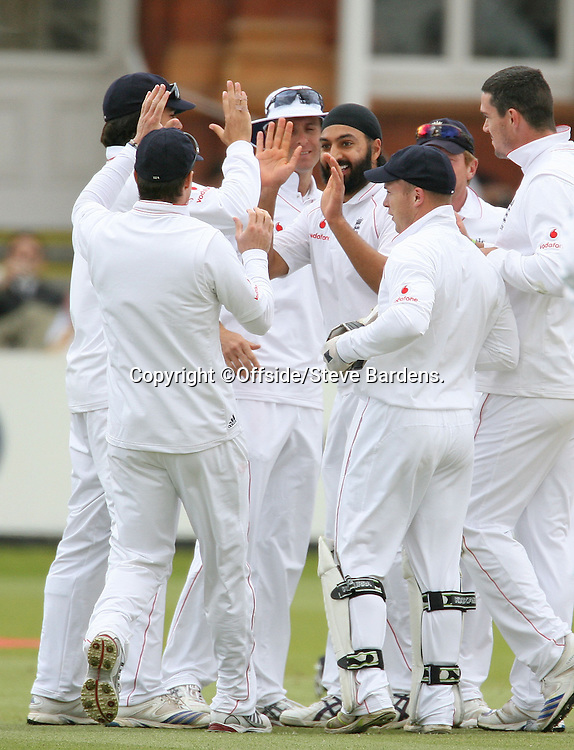 19/05/2008. Cricket - First Test. England v New Zealand. Monty Panesar celebrates catching Ross Taylor lbw with his team mates. London, UK. ©Offside/Steve Bardens.