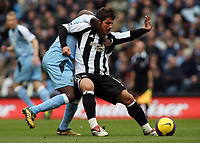 Photo: Paul Thomas.<br /> Manchester City v Newcastle United. The Barclays Premiership. 11/11/2006.<br /> <br /> Hatem Trabelsi (L) of Man City tries to wrestle Emre of the ball.