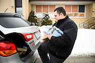 Vicar David Blas, missionary-at-large at LCMS Sheboygan County Hispanic Outreach and St. John's Lutheran Church of Plymouth, Wis., loads Bibles and witnessing materials into his vehicle Thursday, Jan. 28, 2016, at the church in Plymouth. LCMS Communications/Erik M. Lunsford