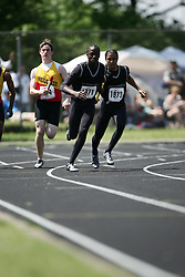 Hamilton, Ontario ---06/06/08--- Kalvin Johnson of St.Marguerite D'YouvilleinBramp competes in the 4X100 meter relay at the 2008 OFSAA Track and Field meet in Hamilton, Ontario..SEAN BURGES