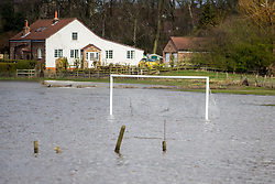 © Licensed to London News Pictures. 18/03/2019. Tadcaster UK. A flooded football pitch in Tadcaster this morning after the River Wharfe broke its banks following the recent heavy rain fall.  Photo credit: Andrew McCaren/LNP