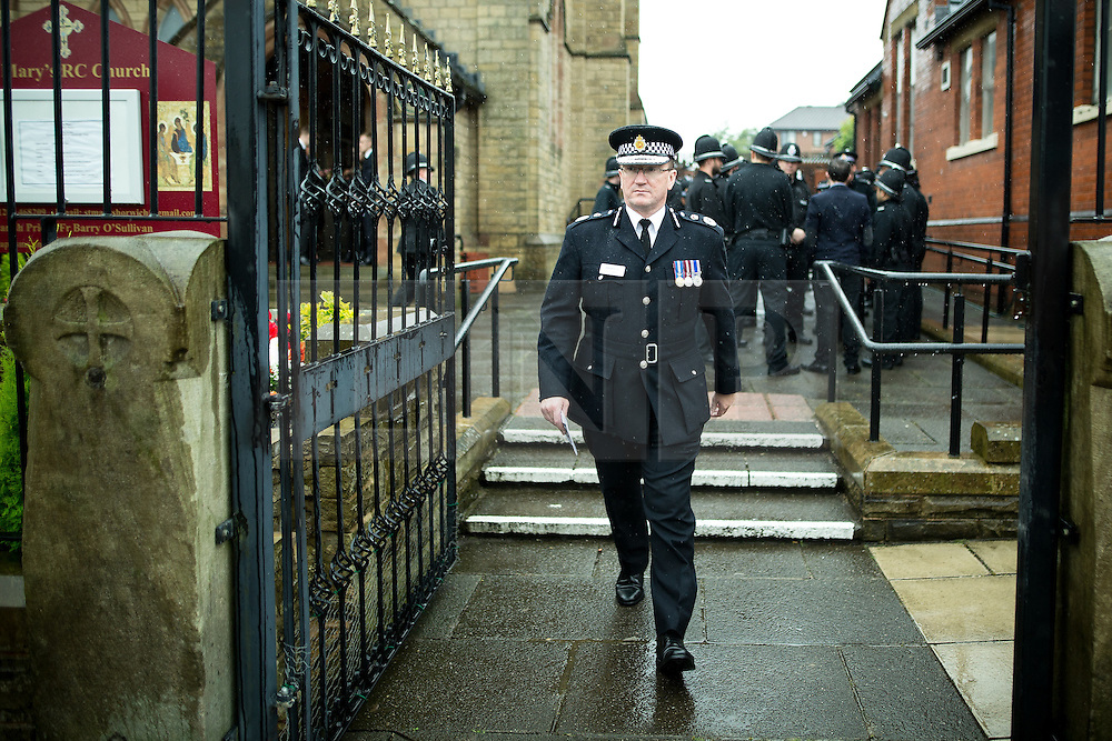 © Licensed to London News Pictures . 15/07/2016 . Bolton , UK . Chief Constable IAN HOPKINS leaving the church , after the service .  The funeral of Special Constable Samantha Derbyshire at St Mary's RC Church in Horwich , Bolton. Derbyshire was struck and killed by an HGV on the M61 motorway following a collision , in the early hours of Monday 11th July 2016 . Photo credit : Joel Goodman/LNP