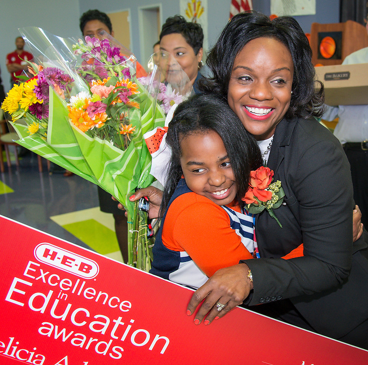 Lockhart Elementary School principal Felicia Adams is congratulated after being named a finalist in the HEB Excellence in Education Awards, April 4, 2014.