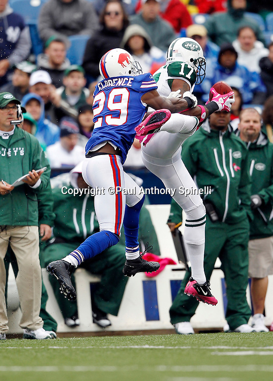 New York Jets wide receiver Braylon Edwards (17) catches a 19 yard fourth quarter pass while covered by Buffalo Bills cornerback Drayton Florence (29) during a NFL week 4 football game against the Buffalo Bills on Sunday, October 3, 2010 in Orchard Park, New York. The Jets won the game 38-14. (©Paul Anthony Spinelli)