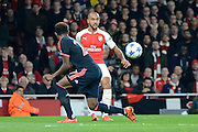 Arsenal striker Theo Walcott chips in the ball during the Champions League  Group F match between Arsenal and Bayern Munich at the Emirates Stadium, London, England on 20 October 2015. Photo by Alan Franklin.
