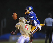 Oxford High's Glenn Gordon (11) is unable to catch a pass while defended by Lafayette High's Brandon Mack (4) at Bobby Holcomb Field in Oxford, Miss. on Thursday, August 30, 2012. Oxford High won 19-0.