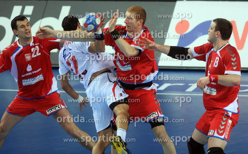 Walid Ben Amor (17) of Tunisia between Marcin Lijewski (22) of Poland and  Karol BIelecki (8) of Poland during 21st Men's World Handball Championship preliminary Group C match between Poland and Tunisia, on January 21, 2009, in Arena Varazdin, Varazdin, Croatia. Win of Poland 31:27. (Photo by Vid Ponikvar / Sportida)
