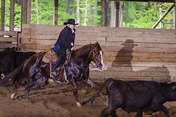 May 21, 2017 - Minshall Farm Cutting 4, held at Minshall Farms, Hillsburgh Ontario. The event was put on by the Ontario Cutting Horse Association. Riding in the Ranch Class is Nancy Poole on MS Smart Freckles owned by the rider.