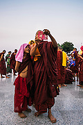 Monks photographing the photgrapher at Kyaiktiyo Pagoda (Golden rock)). Mon State, Myanmar