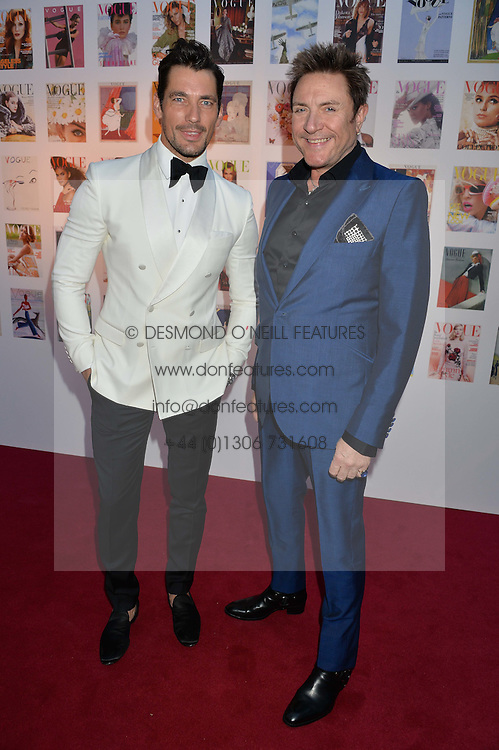Left to right, DAVID GANDY and SIMON LE BON at British Vogue's Centenary Gala Dinner in Kensington Gardens, London on 23rd May 2016.