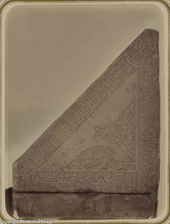 1868<br /> This photograph of an anterior triangular side of the marble Qur'an holder at the main mosque of the Bibi Khanym ensemble in Samarkand (Uzbekistan) is from the archeological part of Turkestan Album. The six-volume photographic survey was produced in 1871-72 under the patronage of General Konstantin P. von Kaufman, the first governor-general (1867-82) of Turkestan, as the Russian Empire&rsquo;s Central Asian territories were called. The album devotes special attention to Samarkand&rsquo;s Islamic architecture, such as 14th- and 15th-century monuments from the reign of Timur (Tamerlane) and his successors. Built in 1399-1405 with the spoils of Timur&rsquo;s campaign in India, the Bibi Khanym ensemble was the location of the city&rsquo;s main, or Friday, mosque, named in homage to Timur&rsquo;s senior wife, Sarai Mulk Khanym. The ensemble centers on the mosque, one of the largest in the Islamic world. Inside the mosque was an enormous Qur'an holder (rihal) donated by Timur&rsquo;s grandson Ulugh Beg and consisting of two massive triangular marble blocks resting on a marble plinth. Shown here is the anterior triangular side of the right block, with carved decoration consisting of floral patterns and bands of cursive script. (Background detail was eliminated to highlight the carving.) In 1875, a few years after this photograph was taken, the lectern was moved into the courtyard in front of the mosque.