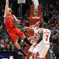 24 March 2012: Toronto Raptors center Andrea Bargnani (7) is fouled by Chicago Bulls center Joakim Noah (13) and scores during the Chicago Bulls 102-101 victory in overtime over the Toronto Raptors at the United Center, Chicago, Illinois, USA.