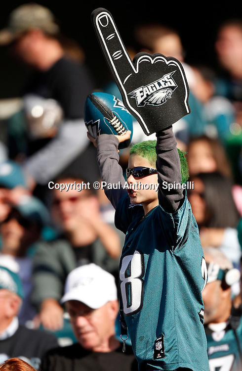 A fan waves a rubber football and foam finger as he cheers for his team during the Philadelphia Eagles NFL week 6 football game against the Atlanta Falcons on Sunday, October 17, 2010 in Philadelphia, Pennsylvania. The Eagles won the game 31-17. (©Paul Anthony Spinelli)