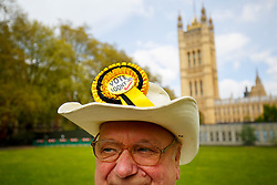 © Licensed to London News Pictures. 01/05/2015. LONDON, UK. Howling Laud Hope, Leader of Official Monster Raving Loony Party posing to media at Victoria Tower Gardens, London on Friday, 1 May 2015. Photo credit : Tolga Akmen/LNP