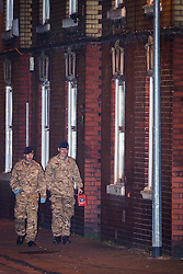 © Licensed to London News Pictures . FILE PICTURE DATED 28/11/2013 of army bomb disposal experts outside the home of Rifleman Ryan McGee on Mellor Street in Eccles , Greater Manchester as today (28th November 2014) McGee has been jailed for making a nail bomb containing 181 screws and pieces of broken glass in his bedroom . Photo credit : Joel Goodman/LNP