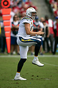 Los Angeles Chargers quarterback Philip Rivers (17) pumps his knee high as he waits for the snap in a shotgun formation in the first quarter during the NFL week 4 regular season football game against the San Francisco 49ers on Sunday, Sept. 30, 2018 in Carson, Calif. The Chargers won the game 29-27. (©Paul Anthony Spinelli)