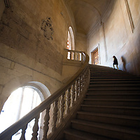 Child climbing a staircase, Palace of Charles V, Granada, Spain