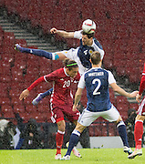 Scotland&rsquo;s Gordon Greer &nbsp;  heads clear from Denmark&rsquo;s Yussuf Poulsen Yurary  - Scotland v Denmark, International challenge match at Hampden Park<br /> <br />  - &copy; David Young - www.davidyoungphoto.co.uk - email: davidyoungphoto@gmail.com