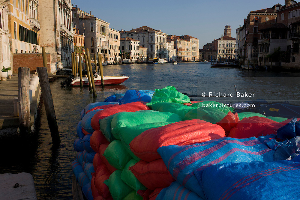 Sacks of supplies ready for unloading from a boat on the Grand Canal, Venice.